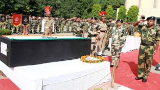Additional DG BSF, Arun Kumar along with other officers and jawans paying  homage to martyred BSF Head Constable, Jitender K Singh, at Jammu on Friday. -Excelsior/ Rakesh