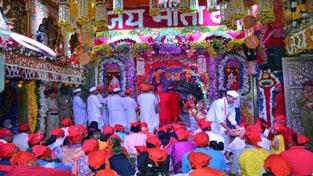 A view of Shri Mata Vaishno Devi Ji Bhawan decorated with flowers.