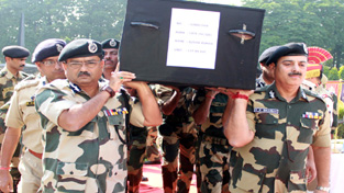 BSF officers carrying body of martyr Sushil Kumar at BSF Headquarters at Paloura.