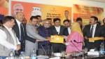 Ministers Zulfkar Ali and Naeem Akhtar launching PMUY scheme at Ganderbal on Tuesday.