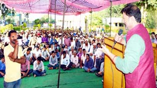 Forest Minister Ch Lal Singh addressing a public meeting on Sunday.
