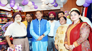 Speaker Legislative Assembly, Kavinder Gupta posing with others after inaugurating a designer store for women at Gole Market in Jammu.    -Excelsior/ Rakesh