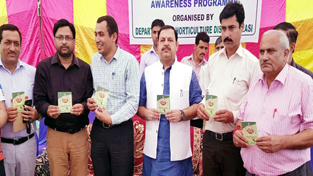 Minister of State for Finance Ajay Nanda and others releasing Handbook-cum-Diary on Friday.