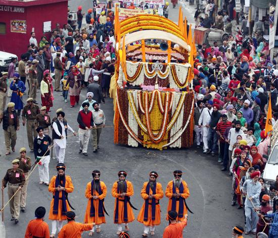 Panj Pyaras leading the Guru Granth Sahib during Nagar Kirtan in Jammu on Saturday. —Excelsior/Rakesh
