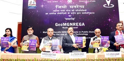 """Union Ministers Narendra Singh Tomar and Dr Jitendra Singh releasing Standard Operating Manual book after jointly launching """"Geo MGNREGA"""", at Vigyan Bhawan, New Delhi on Wednesday."""