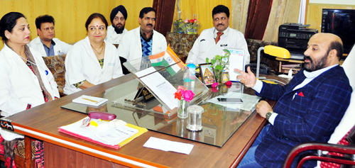 Minister for Health & Medical Education Bali Bhagat chairing a meeting at Jammu on Friday.