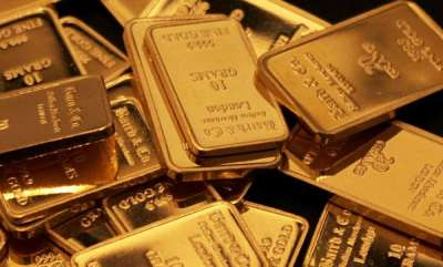 Gold slumps to 10-month low, but silver adds to gains