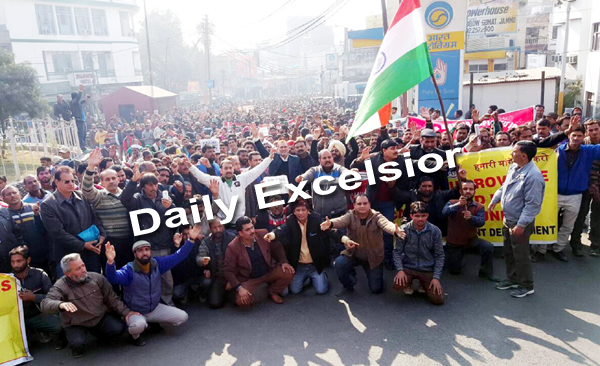 National Health Mission (NHM) employees rally towards Secretariat in Jammu today. Excelsior/Rakesh