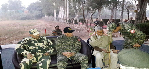 Pakistan retired Armyman sitting with BSF and Rangers before his return at Suchetgarh sector on Wednesday.
