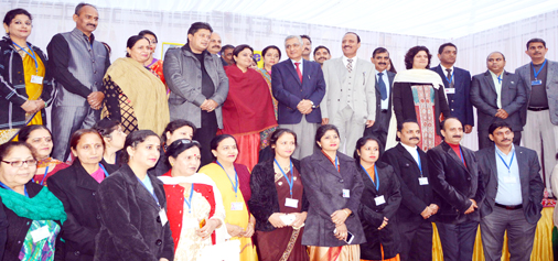 Chief Justice of India, Justice T S Thakur posing for photograph with Ministers, former teachers and officials of various departments at Central Basic Higher Secondary School on Saturday.