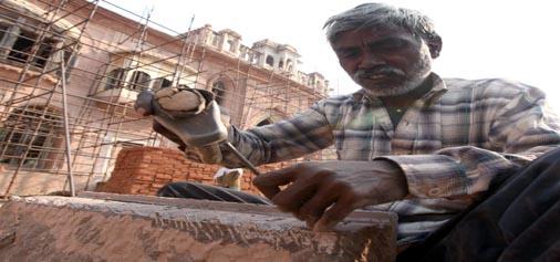 A Rajasthan worker prepares stones for Mubarak Mandi Heritage Complex in Jammu. —Excelsior/Rakesh