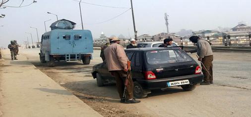 Security officials check vehicles on Srinagar- Jammu National Highway. -Excelsior/Shakeel