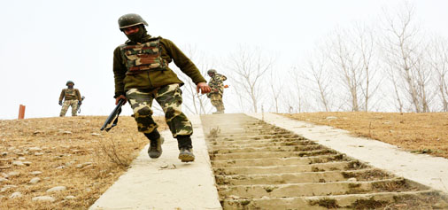 Troops during gunbattle at Arwani, Anantnag on Friday. -Excelsior/ Younis Khaliq