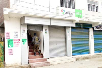 J&K Bank Ratnipora branch in Pulwama district, which was looted by the militants. -Excelsior/ Younis Khaliq