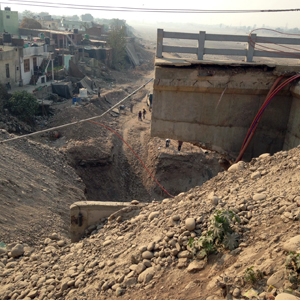Approach road to 4th Tawi bridge yet to be reconstructed by JKPCC. —Excelsior/Rakesh