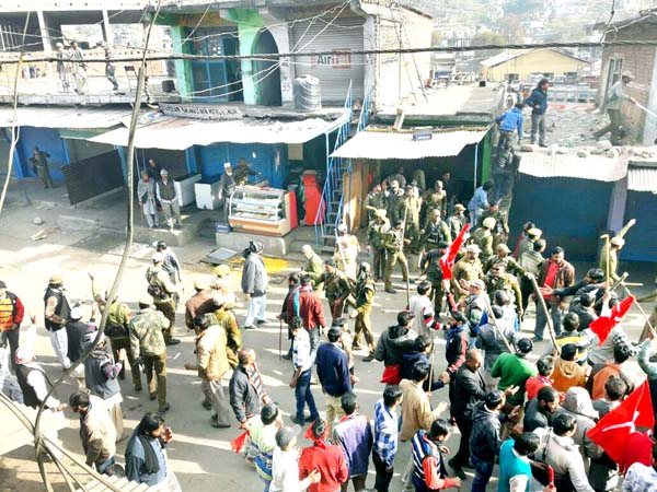 Police preventing NC workers from closing shops during violent clash at Mendhar on Thursday.