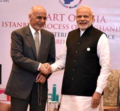 Prime Minister Narendra Modi meeting President of Afghanistan, Dr. Mohammad Ashraf Ghani, at Heart of Asia in Amritsar on Sunday. (UNI)