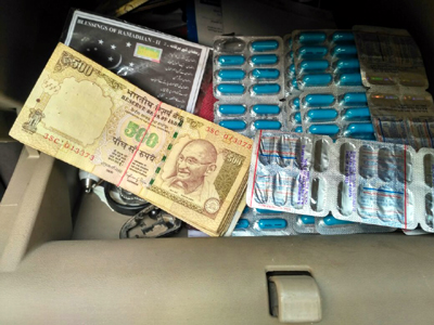 Old currency notes and banned capsules seized by police at Lakhanpur on Sunday.