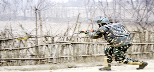 An Army jawan takes position during an encounter with militants at Arwani on Thursday. —Excelsior/Sajad Dar