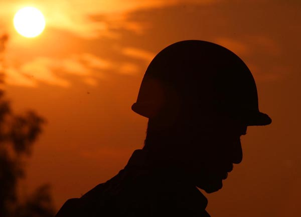 An Army jawan mans a post at Sun rise in Jammu. -Excelsior/Rakesh