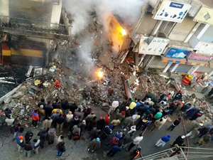 People trying to control devasting fire in Vijaypur market. — Excelsior/Gautam