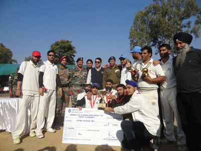 Poonch Royals team posing alongwith chief guest and other dignitaries after clinching the T20 title in Rajouri.