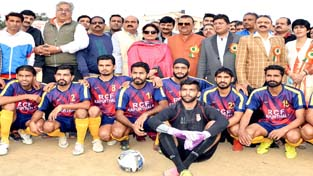 Footballers posing along with Minister for Industries and Commerce, Chander Parkash Ganga in Jammu on Saturday.