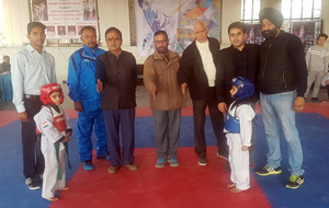 19th District Jammu Taekwondo Championship being inaugurated by the chief guest and other dignitaries in Jammu on Monday.