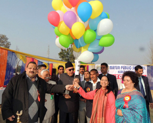 President National Conference Dr Farooq Abdullah releasing balloons while inaugurating Annual Day Function of Mayur Public School at Jhiri in Jammu on Monday.