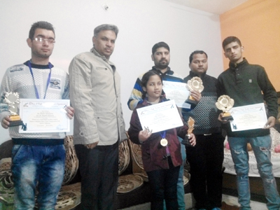 Winners of titles posing for a photograph after excelling in Chess Tournament at Udhampur.