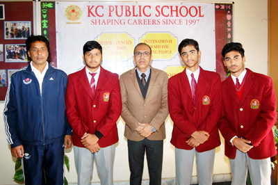 Meritorious students of KCPS posing for a photograph alongwith their Principal Amarendra Mishra in Jammu on Tuesday.