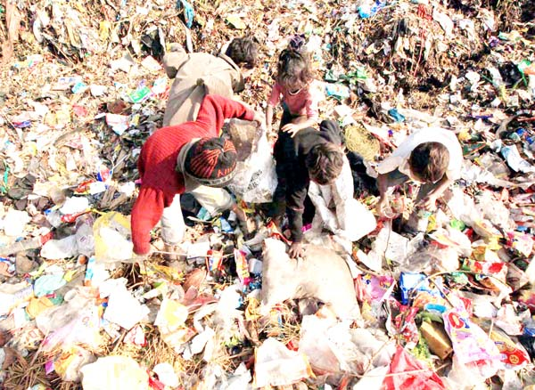 Children search for recyclable garbage on the outskirts of Jammu. --Excelsior/Rakesh