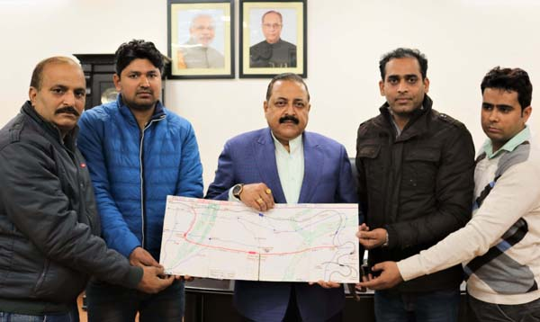 "Union Minister Dr Jitendra Singh receiving a Railway line plan prepared by a group of young technocrats representing ""Nav Kathua Nirman Samiti"", at New Delhi on Friday."