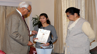 Governor NN Vohra and First Lady of the State, Usha Vohra felicitating ace chess player, Meenal Gupta for her outstanding performance in Under-14 Girls Category in Commonwealth Chess Tournament, which was held in Sri Lanka earlier this year. Meenal and his father, Atul Gupta met the Governor at Raj Bhawan in Jammu, yesterday.