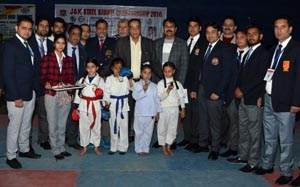 Young Karatekas posing alongwith dignitaries during inaugural ceremony of J&K State Karate Championship.