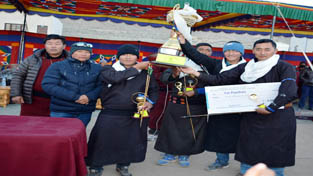 Ladakh Scout Red team holding  trophy while posing for a photograph.    —Excelsior/Stanzin
