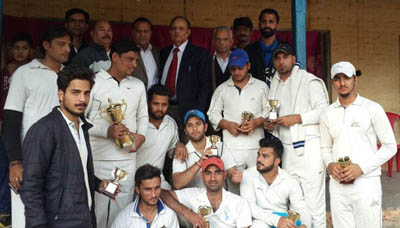 Triumphant KCC Akhnoor team players posing alongwith chief guest at BHSS Akhnoor in Jammu on Sunday.