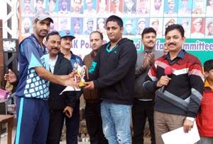 Man of the Match award being presented to Wasim Raza at Sports Stadium, Kathua on Monday.
