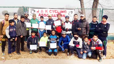 Winners of District Srinagar Cycling Championship posing for a group photograph.
