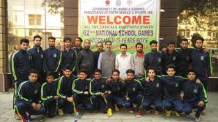 J&K Football team to participate in 62nd National School Games at Jammu posing for a group photograph alongwith coach and other dignitaries.