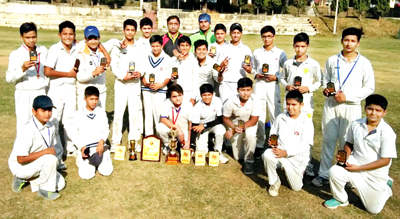 Winners displaying trophies while posing for group photograph.