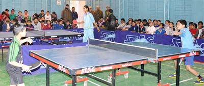 Players in action during a match of District Level Table Tennis Tournament at Udhampur.