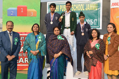 Medallists posing alongwith Minister of State for Education, Priya Sethi and other dignitaries at DPS in Jammu.