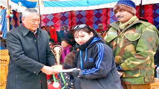 Winner being felicitated by the chief guest during concluding ceremony of Sports Festival at Leh. -Excelsior/Stanzin
