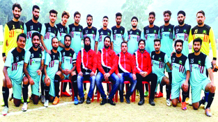 J&K team posing for a group photograph alongwith officials after defeating Uttarakhand in Santosh Trophy on Friday.