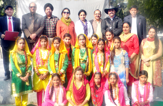 Winners of Divisional Folk Dance Competition posing alongwith dignitaries in Jammu.