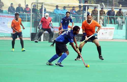 Players in action during a match at K K Hakhu Hockey Stadium in Jammu. -Excelsior/Rakesh