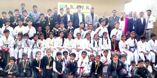 Medalists of16th J&K State Karate-Do Championship posing alongwith dignitaries at Bari Brahmana in Samba on Thursday.