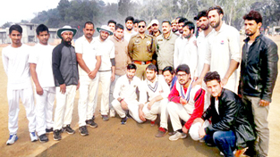 Winners of T20 match posing along with chief guest at Reasi on Thursday.