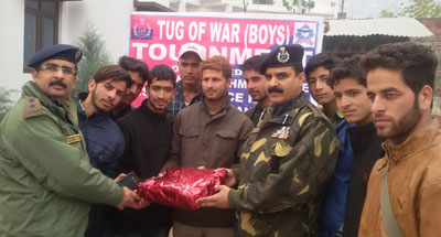 Winners of Tug of War competition being felicitated by dignitaries at Ramban on Friday.
